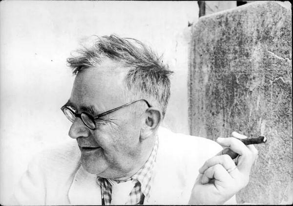 Karl Barth enjoying a cigar.